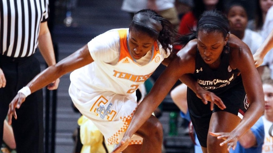 Tennessee forward Jasmine Jones (2) and South Carolina center Elem Ibiam (33) battle for a loose ball in the first half of an NCAA college basketball game on Sunday, March 2, 2014, in Knoxville, Tenn. (AP Photo/Wade Payne)