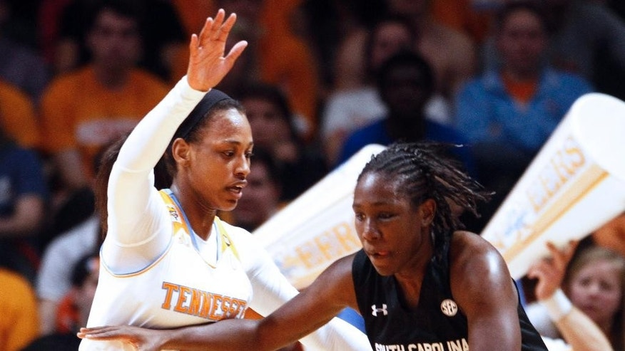 South Carolina forward Aleighsa Welch (24) drives against Tennessee forward Bashaara Graves in the first half of an NCAA college basketball game on Sunday, March 2, 2014, in Knoxville, Tenn. (AP Photo/Wade Payne)
