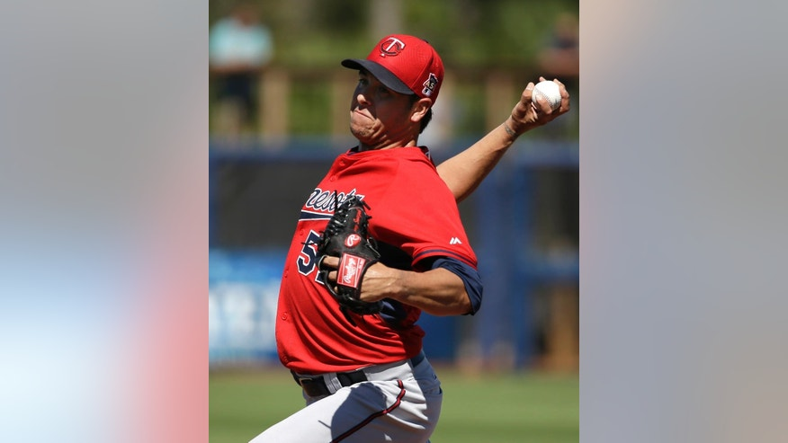 Minnesota Twins' Anthony Swarzak winds up for a warmup pitch in the third inning of an exhibition baseball game against the Tampa Bay Rays, Sunday, March 2, 2014, in Port Charlotte, Fla. (AP Photo/Steven Senne)