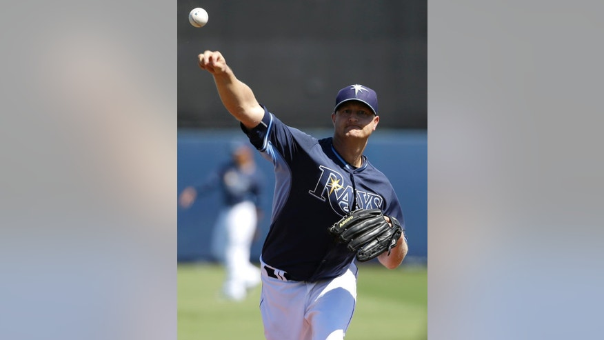 Tampa Bay Rays pitcher Alex Cobb warms up during the first inning of an exhibition baseball game against the Minnesota Twins, Sunday, March 2, 2014, in Port Charlotte, Fla. (AP Photo/Steven Senne)