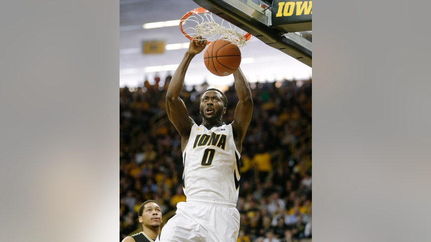 Iowa center Gabriel Olaseni dunks during the first half of the Big Ten Conference NCAA men's basketball game against Purdue at Carver-Hawkeye Arena on Sunday, March 2, 2014, in Iowa City, Iowa. (AP Photo/Jim Slosiarek)