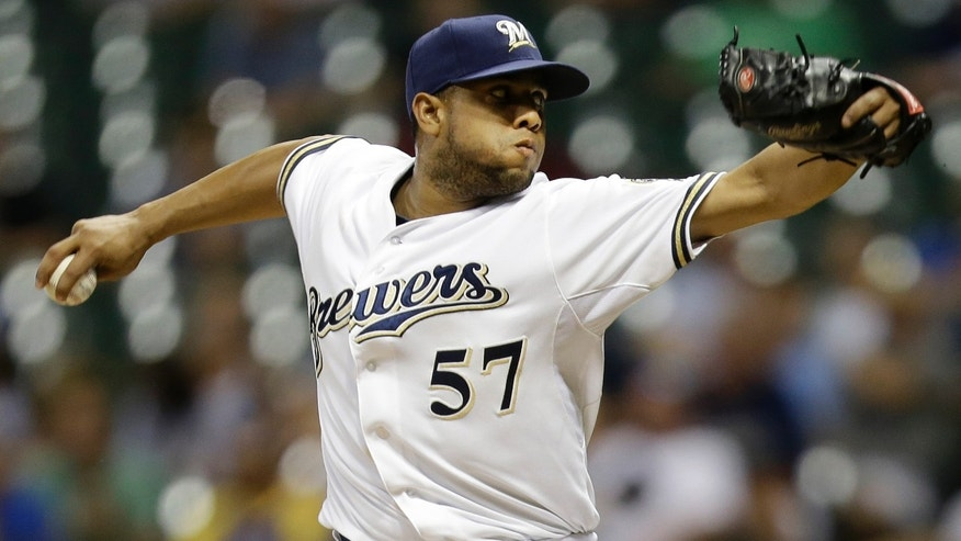 MILWAUKEE, WI - JULY 18: Francisco Rodriguez #57 of the Milwaukee Brewers pitches in the top of the ninth inning against the Miami Marlins at Miller Park on July 18, 2013 in Milwaukee, Wisconsin. (Photo by Mike McGinnis/Getty Images)