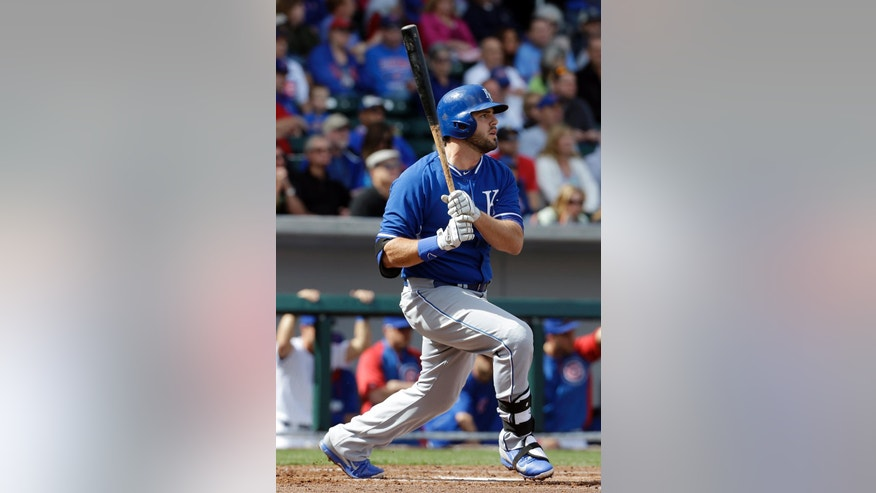 Kansas City Royals' Mike Moustakas hits a home run during the second inning of an exhibition spring training baseball game against the Chicago Cubs, Sunday, March 2, 2014, in Mesa, Ariz. (AP Photo/Morry Gash)
