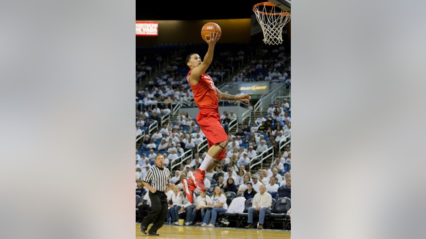 New Mexico's Kendall Williams lays the ball up on a fast break against Nevada during an NCAA college basketball game Sunday, March 2, 2014, in Reno, Nev. (AP Photo/Reno Gazette-Journal, Tom R. Smedes) CARSON CITY OUT NO SALES
