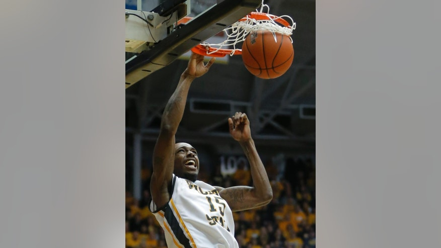 Wichita State's Nick Wiggins dunks against Missouri State during the second half of an NCAA college basketball game in Wichita, Kansas., Saturday, March 1, 2014.  (AP Photo/The Wichita Eagle, Travis Heying) LCOAL TV OUT; MAGS OUT; LOCAL RADIO OUT; LOCAL INTERNET OUT