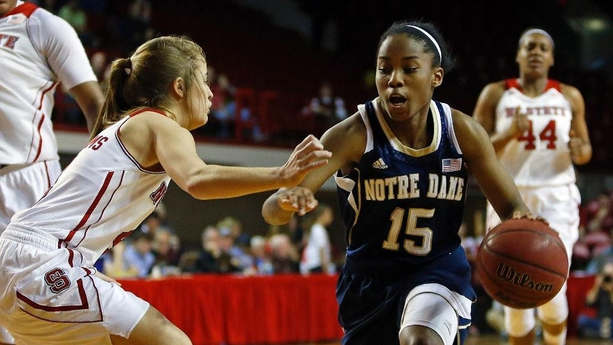 Notre Dame 's Lindsay Allen (15) faces off against North Carolina State 's Ashley Williams during the first half of an NCAA college basketball game in Raleigh, N.C., Sunday, March 2, 2014. (AP Photo/Karl B DeBlaker)