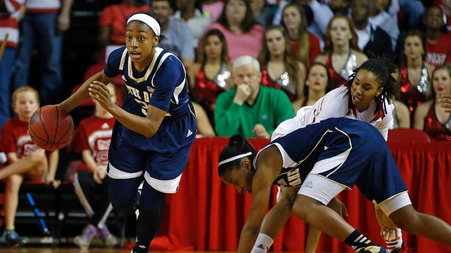 Notre Dame 's Jewell Loyd (32) comes away with the ball after teammate Lindsay Allen, fron right, collided with North Carolina State 's Krystal Barrett during the first half of an NCAA college basketball game in Raleigh, N.C., Sunday, March 2, 2014. (AP Photo/Karl B DeBlaker)