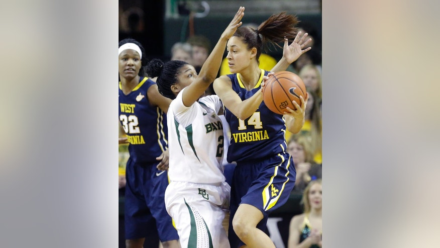 West Virginia forward Jess Harlee (14) looks to pass against Baylor guard Niya Johnson (2) during the first quarter of an NCAA college basketball game Sunday, March 2, 2014, in Waco, Texas. (AP Photo/LM Otero)