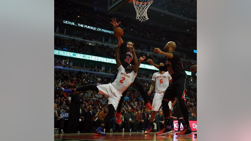 New York Knicks point guard Raymond Felton (2) has his shot blocked by Chicago Bulls center Joakim Noah (13) during the first half of an NBA basketball game on Sunday, March 2, 2014, in Chicago. (AP Photo/Jeff Haynes)