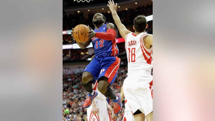 Detroit Pistons guard Will Bynum (12) drives past Houston Rockets'  Omri Casspi (18) for a layup during the first half of an NBA basketball game, Saturday, March 1, 2014, in Houston. (AP Photo/Bob Levey)