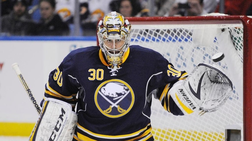 In this Tuesday, Feb. 25, 2014, photo, Buffalo Sabres goaltender Ryan Miller reaches out with his glove to stop the puck during an NHL hockey game against the Carolina Hurricanes in Buffalo, N.Y. The Sabres traded Miller and captain Steve Ott to the St. Louis Blues on Friday, Feb. 28, for goalie Jaroslav Halak, forward Chris Stewart, prospect William Carrier, a 2015 first-round pick and a 2016 third-round pick. (AP Photo/Gary Wiepert)