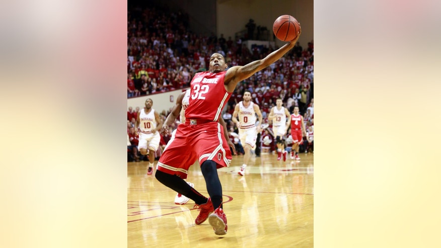 Ohio State guard Lenzelle Smith Jr. (32) reaches out to grab an errant pass in the first half of an NCAA basketball game against Indiana in Bloomington, Ind. Sunday, March 2, 2014. (AP Photo/R Brent Smith)