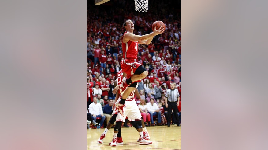 Ohio State guard Aaron Craft eyes the basket as he goes up to shoot the basketball in the first half of an NCAA basketball game against Indiana in Bloomington, Ind. Sunday, March 2, 2014. (AP Photo/R Brent Smith)