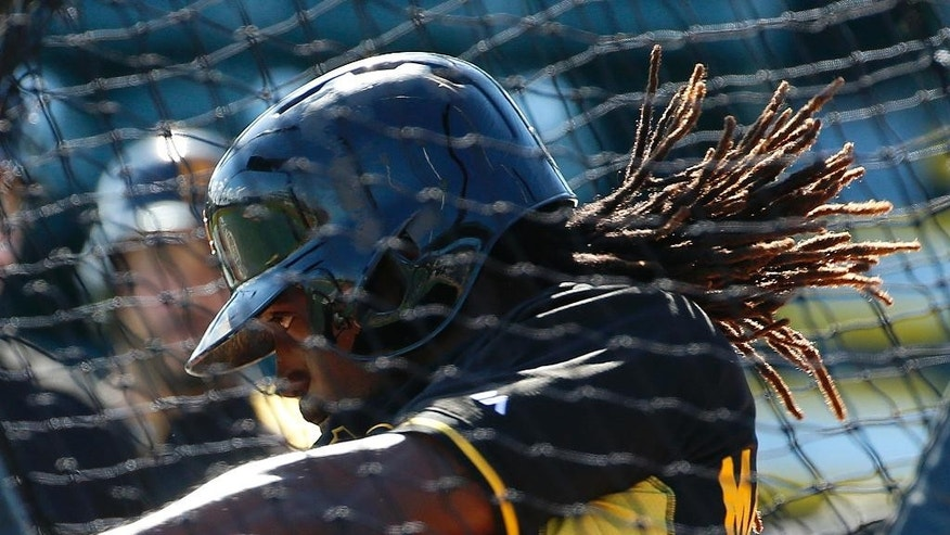 Pittsburgh Pirates' Andrew McCutchen hits during batting practice before  an exhibition spring training baseball game  against the Boston Red Sox in Bradenton, Fla., Monday, March 3, 2014. (AP Photo/Gene J. Puskar)