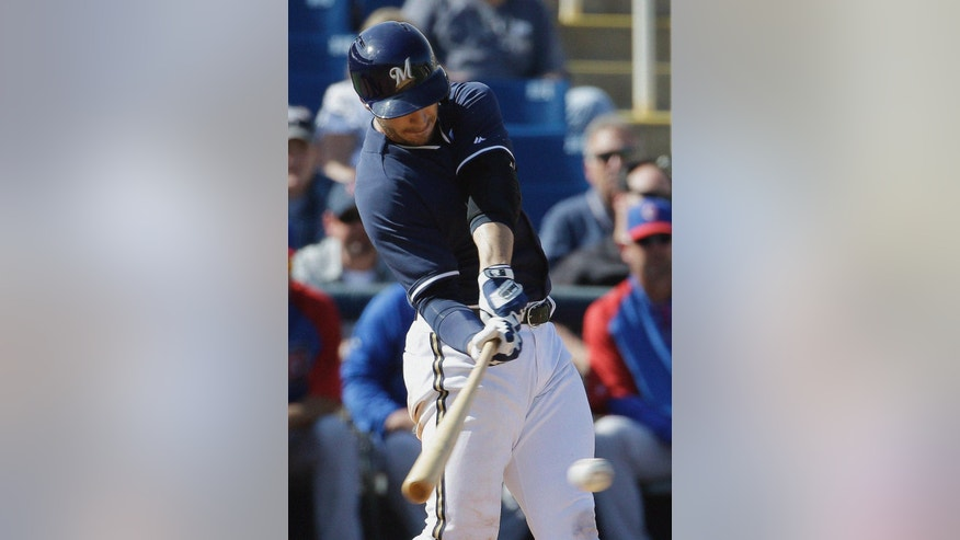 Milwaukee Brewers' Ryan Braun hits a single during the fifth inning of an exhibition spring training baseball game against the Chicago Cubs Monday, March 3, 2014, in Phoenix. (AP Photo/Morry Gash)