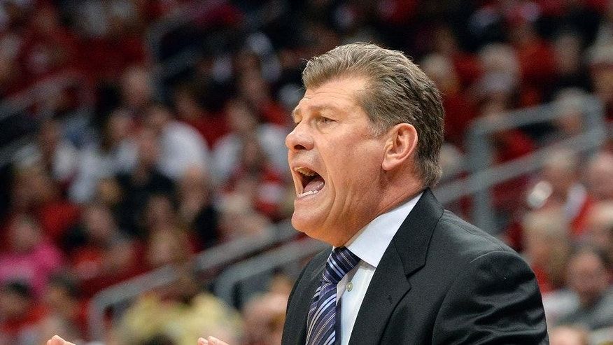 Connecticut head coach Geno Auriemma shouts instructions to his team during the first half of an NCAA college basketball game against Louisville, Monday, March 3, 2014, in Louisville, Ky. (AP Photo/Timothy D. Easley)