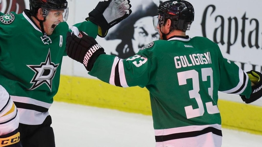 Dallas Stars defenseman Alex Goligoski (33) celebrates his goal with teammate Shawn Horcoff during the second period of an NHL hockey game against the Buffalo Sabres Monday, March 3, 2014, in Dallas. (AP Photo/LM Otero)