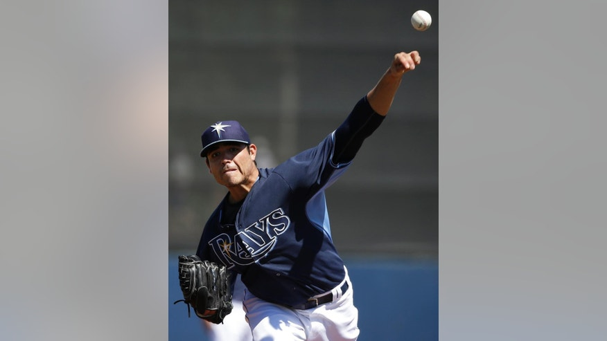 Tampa Bay Rays pitcher Matt Moore delivers a warm-up throw in the first inning an exhibition baseball game against the Philadelphia Phillies, Monday, March 3, 2014, in Port Charlotte, Fla. (AP Photo/Steven Senne)