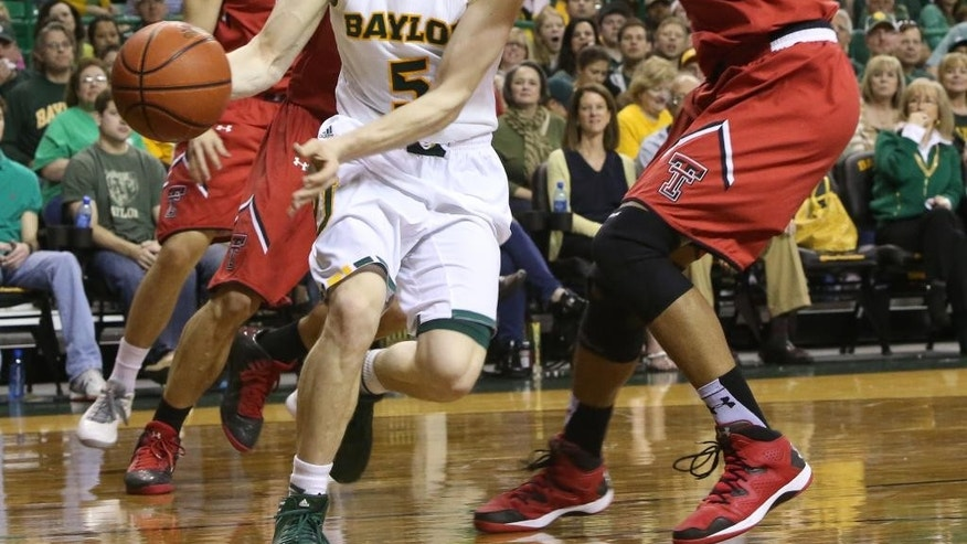 Baylor guard Brady Heslip (5) is pressured by Texas Tech Jordan Tolbert (32) during the first half of an NCAA college basketball game, Saturday, March, 1, 2014, in Waco, Texas. (AP Photo/Waco Tribune Herald, Michael Bancale)