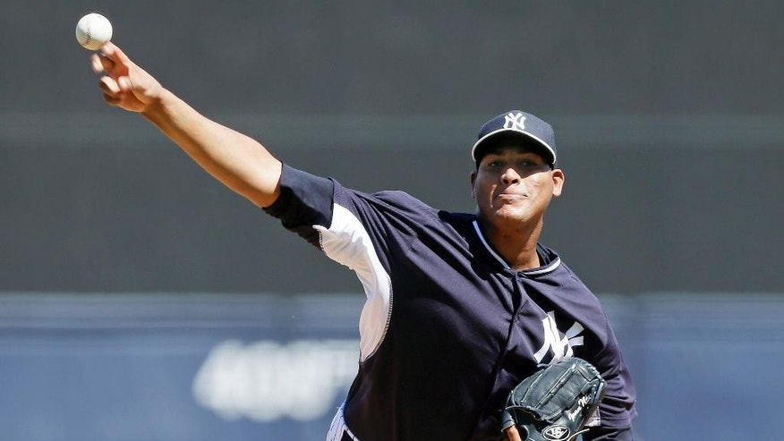 New York Yankees starting pitcher Ivan Nova throws during the first inning of an exhibition baseball game against the Washington Nationals, Monday, March 3, 2014, in Tampa, Fla. (AP Photo/Charlie Neibergall)