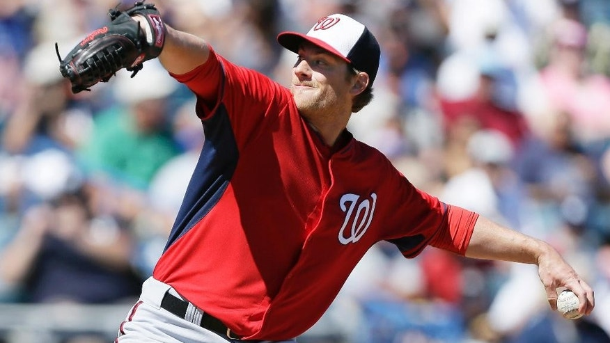 Washington Nationals starting pitcher Ross Detwiler throws a pitch during the first inning of an exhibition baseball game against the New York Yankees Monday, March 3, 2014, in Tampa, Fla. (AP Photo/Charlie Neibergall)