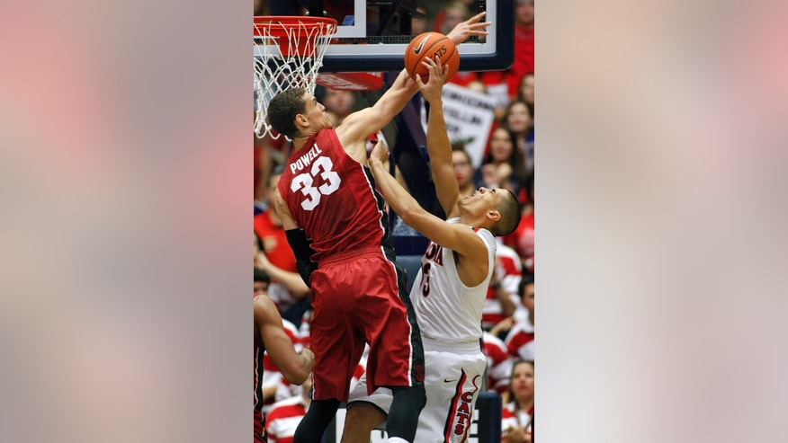 Stanford's Dwight Powell (33) attempts to block the shot of Arizona's Nick Johnson, right, in the first half of an NCAA college basketball game on Sunday, March 2, 2014 in Tucson, Ariz. (AP Photo/John MIller)