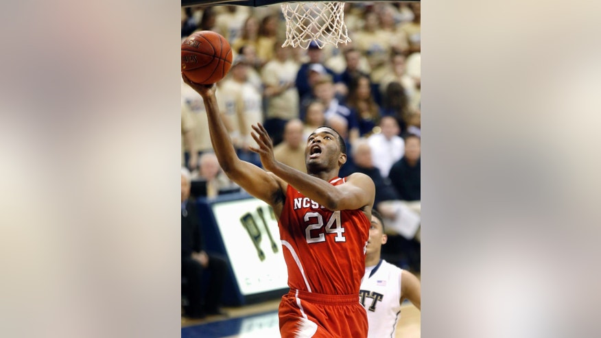 North Carolina State's T.J. Warren (24) shoots in front of James Robinson during the second half of an NCAA college basketball game on Monday, March 3, 2014, in Pittsburgh. (AP Photo/Keith Srakocic)