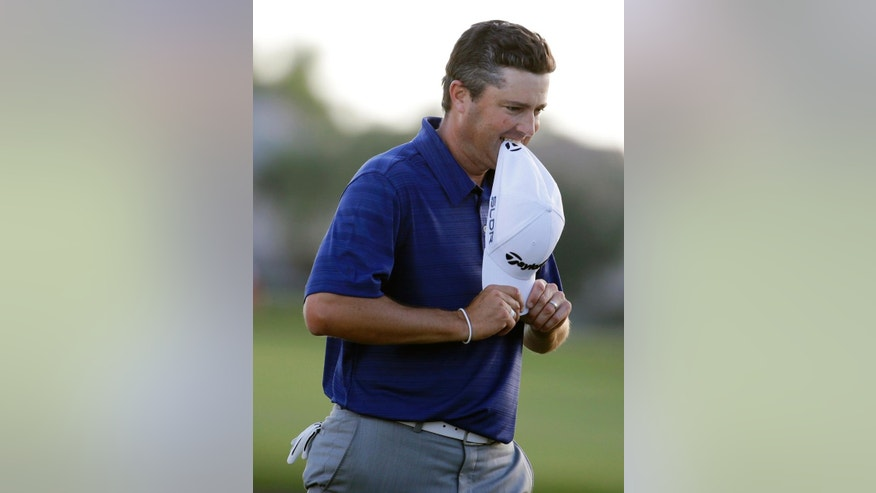 Ryan Palmer bites his cap after a bogey on the 18th hole during the final round of the Honda Classic golf tournament on Sunday, March 2, 2014, in Palm Beach Gardens, Fla. Russell Henley won the tournament. (AP Photo/Lynne Sladky)