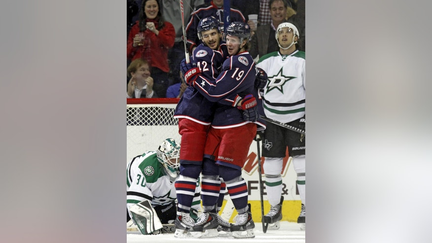Columbus Blue Jackets' Artem Anisimov (42), of Russia, and teammate Ryan Johansen (19) celebrate Anisimov's goal in front of Dallas Stars' Dan Ellis (30) and Brenden Dillon (4) in the first period of an NHL hockey game in Columbus, Ohio, Tuesday, March 4, 2014. Columbus won 4-2. (AP Photo/Paul Vernon)