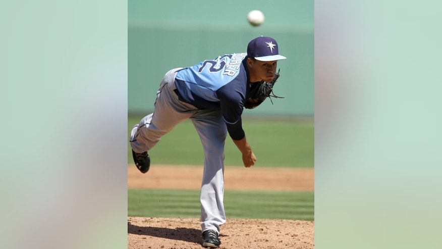 Tampa Bay Rays pitcher Chris Archer delivers a warm-up pitch in the first inning of an exhibition baseball game against the Boston Red Sox, Tuesday, March 4, 2014, in Fort Myers, Fla. (AP Photo/Steven Senne)
