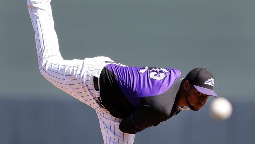 Colorado Rockies starting pitcher Juan Nicasio pitches to a San Francisco Giants batter during the first inning of an exhibition spring training baseball game Tuesday, March 4, 2014, in Scottsdale, Ariz. (AP Photo/Gregory Bull)