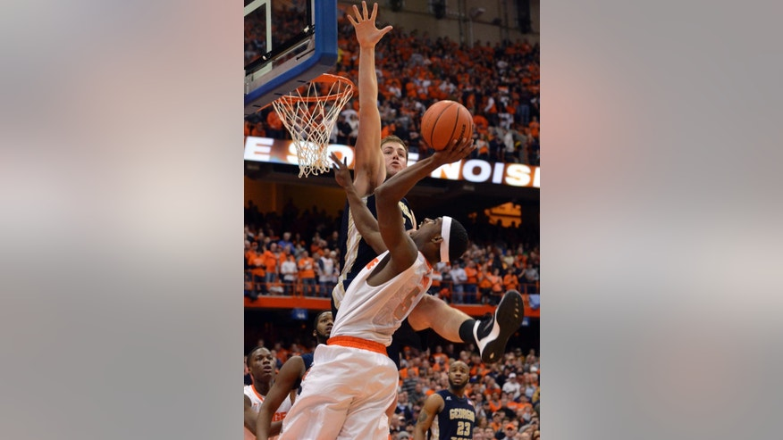 Syracuse's C. J. Fair (5) drives against Georgia Tech's Daniel Miller during the second half of an NCAA college basketball game in Syracuse, N.Y., Tuesday, March 4, 2014. Georgia Tech won 67-62. (AP Photo/Kevin Rivoli)