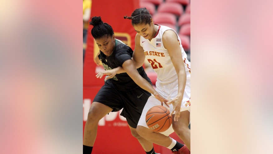 Baylor's Sune Agbuke reaches in and knocks the ball away from Iowa State Tenisha Matlock during the first half of an NCAA college basketball game in Ames, Iowa, Tuesday, March 4, 2014. Baylor won 70-54. (AP Photo/Justin Hayworth)
