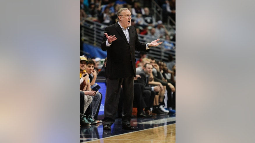 Minnesota Timberwolves head coach Rick Adelman yells at a referee during the first quarter of an NBA basketball game against the Denver Nuggets Monday, March 3, 2014, in Denver. (AP Photo/Barry Gutierrez)
