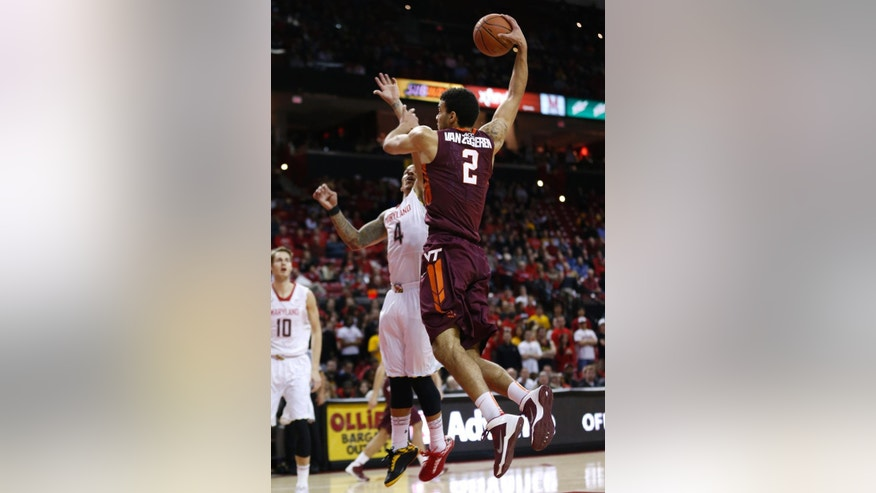 Virginia Tech forward Joey Van Zegeren (2) goes up for a dunk over Maryland guard Seth Allen during the first half of an NCAA college basketball game in College Park, Md., Tuesday, March 4, 2014. (AP Photo/Patrick Semansky)