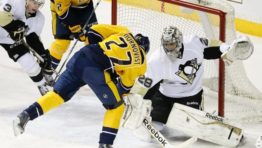Pittsburgh Penguins goalie Marc-Andre Fleury (29) blocks a shot by Nashville Predators forward Patric Hornqvist (27), of Sweden, in the first period of an NHL hockey game Tuesday, March 4, 2014, in Nashville, Tenn. (AP Photo/Mark Humphrey)