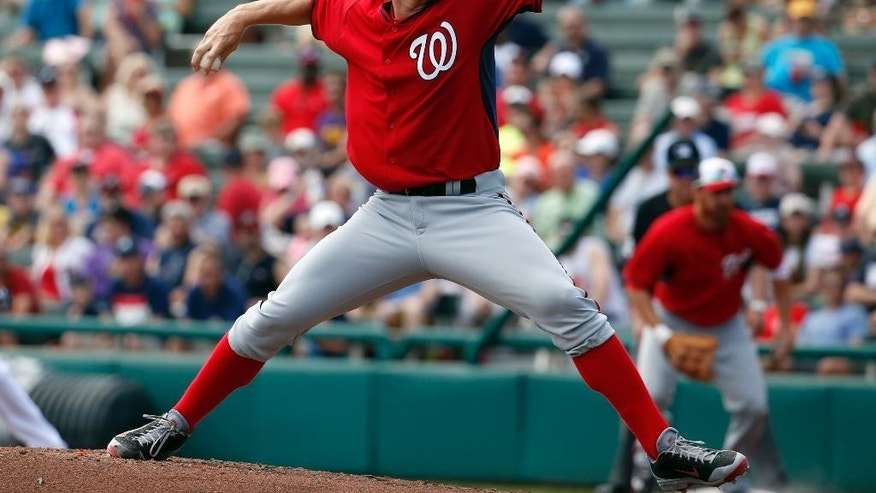 Washington Nationals starting pitcher Stephen Strasburg (37) throws in the second inning of a spring exhibition baseball game against the Atlanta Braves, Tuesday, March 4, 2014, in Kissimmee, Fla. (AP Photo/Alex Brandon)