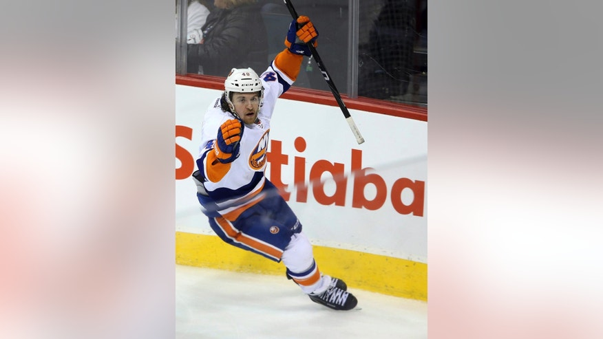 New York Islanders' Michael Grabner celebrates his game-winning goal against the Winnipeg Jets during overtime of an NHL hockey game in Winnipeg, Manitoba, Tuesday, March 4, 2014. The Islanders won 3-2. (AP Photo/The Canadian Press, Trevor Hagan)