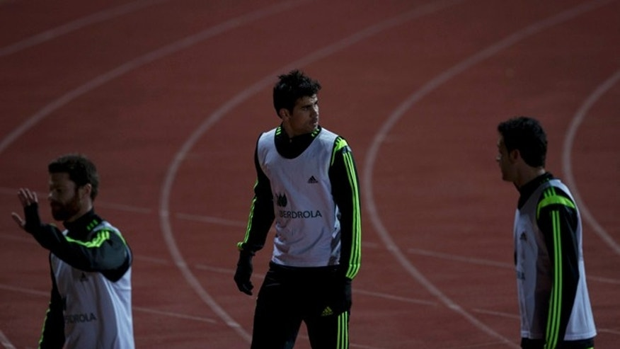 Diego Costa, center, leaves his first training session with Spain in Madrid, Monday March 3, 2014. Spain will play Italy Wednesday in a friendly soccer match. (AP Photo/Paul White)