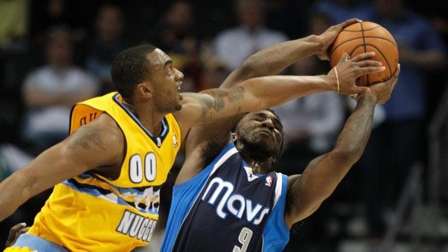 Denver Nuggets forward Darrell Arthur (00) challenges Dallas Mavericks forward Jae Crowder (9) to a rebound in the first quarter of an NBA game in Denver on Wednesday, March 5, 2014.(AP Photo/Joe Mahoney)