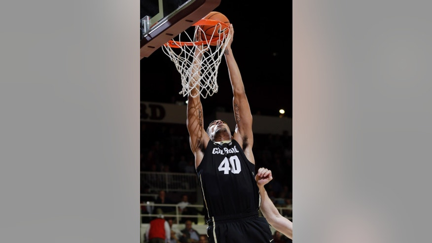 Colorado forward Josh Scott dunks against Stanford during the first half of an NCAA college basketball game Wednesday, March 5, 2014, in Stanford, Calif. (AP Photo/Marcio Jose Sanchez)