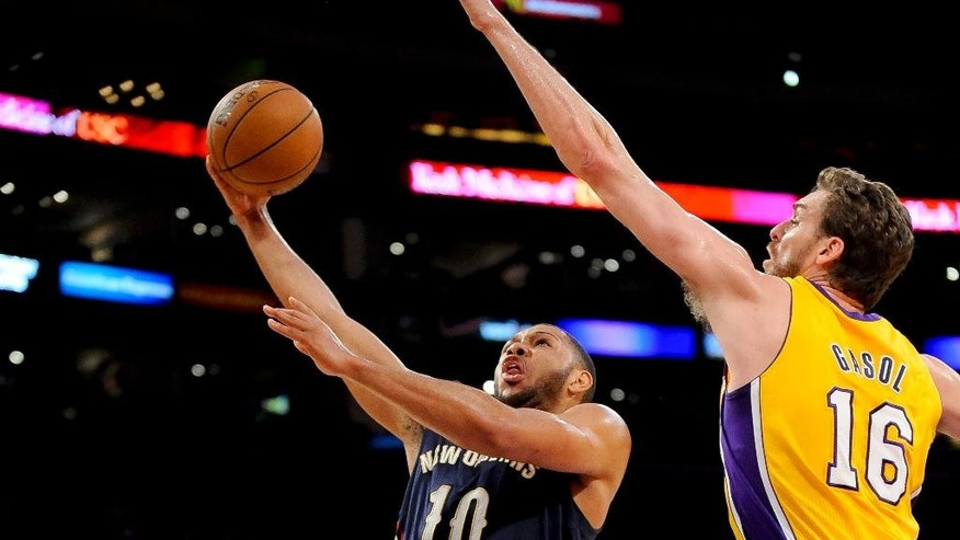 New Orleans Pelicans guard Eric Gordon (10) gets by Los Angeles Lakers center Pau Gasol (16) on a fast break for a basket in the first half of an NBA basketball game, Tuesday, March 4, 2014, in Los Angeles.(AP Photo/Gus Ruelas)