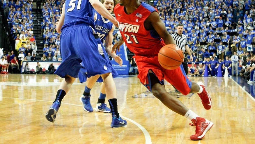 Dayton's Dyshawn Pierre (21) goes to the basket around Saint Louis' Rob Loe (51) during the first half of an NCAA college basketball game Wednesday, March 5, 2014, in St. Louis. (AP Photo/Scott Kane)