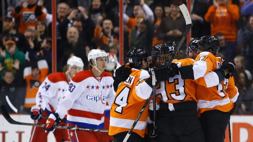 Philadelphia Flyers' players celebrate after a goal by Jakub Voracek, of the Czech Republic, during the first period of an NHL hockey game against the Washington Capitals, Wednesday, March 5, 2014, in Philadelphia. (AP Photo/Matt Slocum)