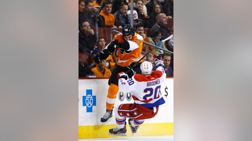 Philadelphia Flyers' Zac Rinaldo, left, collides with Washington Capitals' Troy Brouwer during the first period of an NHL hockey game, Wednesday, March 5, 2014, in Philadelphia. (AP Photo/Matt Slocum)