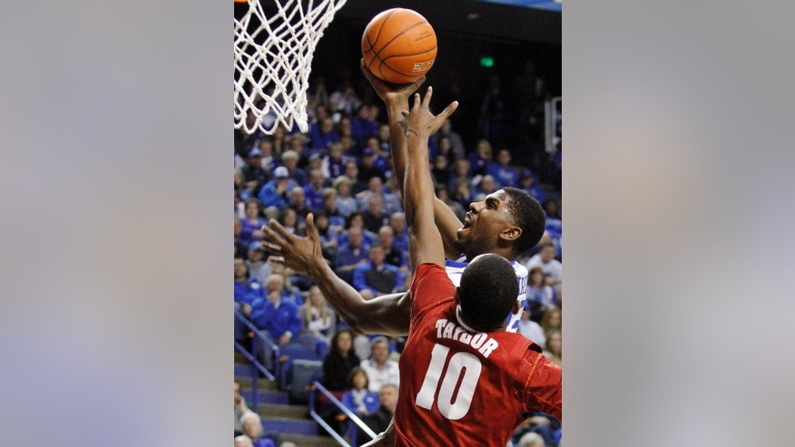 Kentucky's Alex Poythress, top, shoots as Alabama's Jimmie Taylor (10) defends during the first half of an NCAA college basketball game, Tuesday, March 4, 2014, in Lexington, Ky. (AP Photo/James Crisp)
