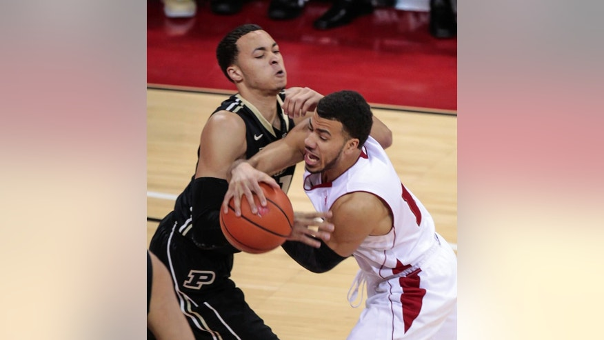 Purdue's Kendall Stephens, left, and Wisconsin's Traevon Jackson battle for the ball during the first half of an NCAA college basketball game Wednesday, March 5, 2014, in Madison, Wis. (AP Photo/Andy Manis)