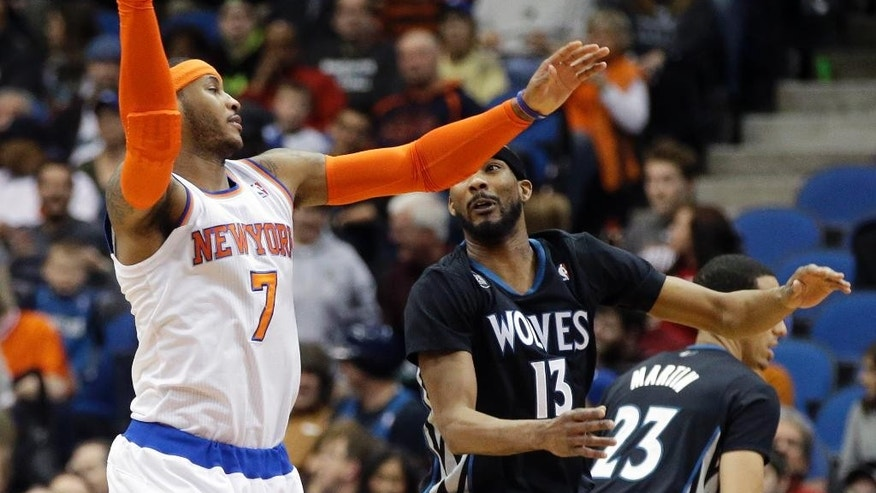 New York Knicks' Carmelo Anthony, left, beats Minnesota Timberwolves' Corey Brewer to a pass in the first quarter of an NBA basketball game, Wednesday, March 5, 2014, in Minneapolis. (AP Photo/Jim Mone)