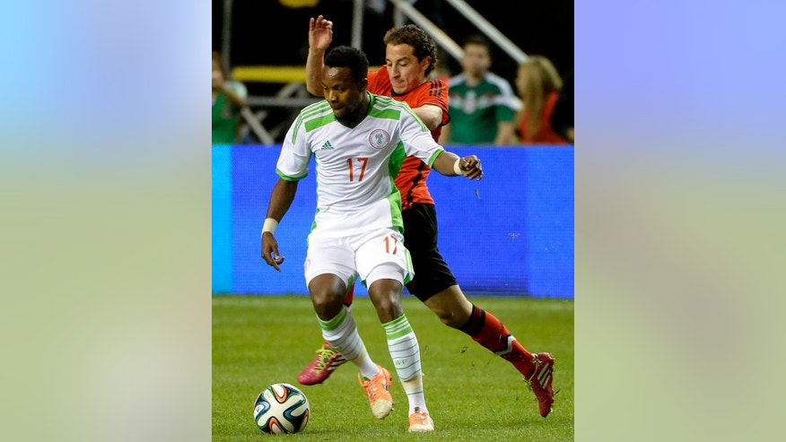 Nigeria's Ogenyi Onazi (17) controls the ball in front of Mexico's Andres Guardado during the first half of an international friendly soccer match Wednesday, March 5, 2014, in Atlanta. (AP Photo/David Tulis)
