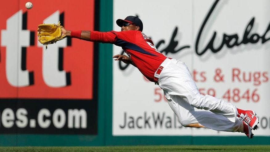 St. Louis Cardinals left fielder Joey Butler dives but cannot reach a triple by Boston Red Sox's Mike Carp during the sixth inning of an exhibition baseball game Wednesday, March 5, 2014, in Jupiter, Fla. (AP Photo/Jeff Roberson)